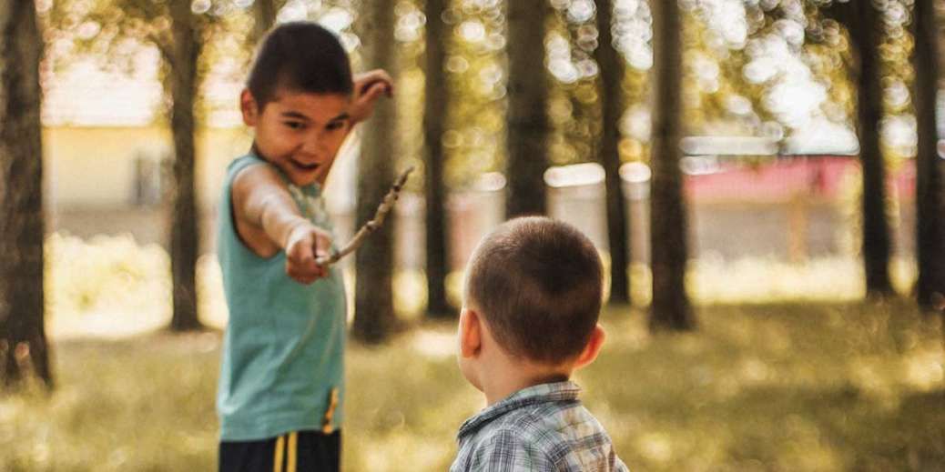 kids playing with sticks